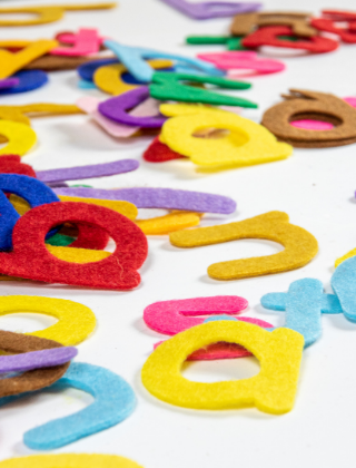 felt colorful alphabet letters scattered randomly